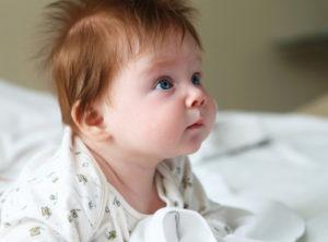 развитие ребенка 4 месяца что должен уметь